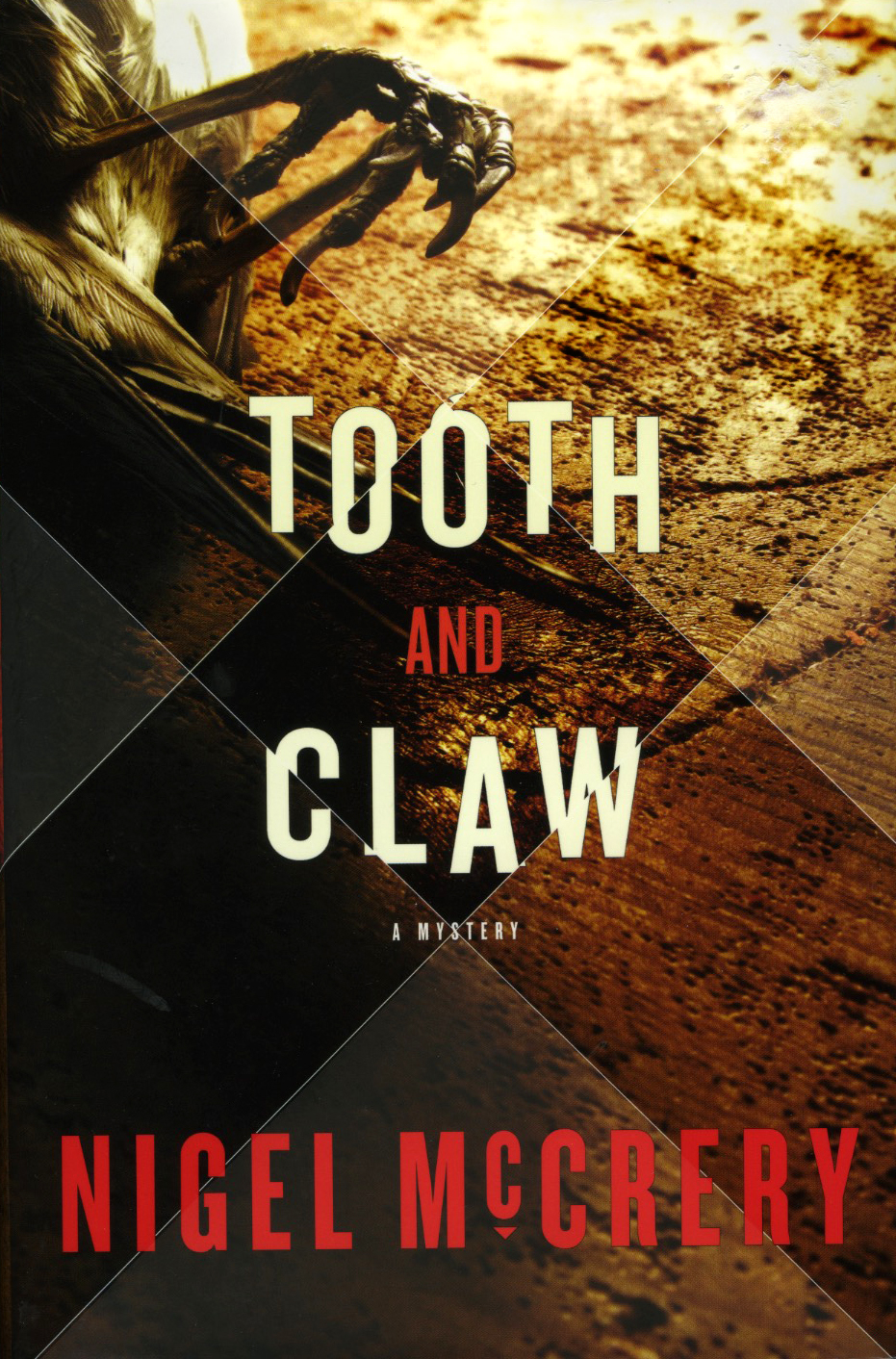 Tooth and Claw, by Nigel McCreryPhotograph by Jessica Hines, cover design by Brian Barth, Random House Books